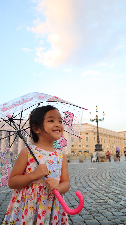 toddler with umbrella