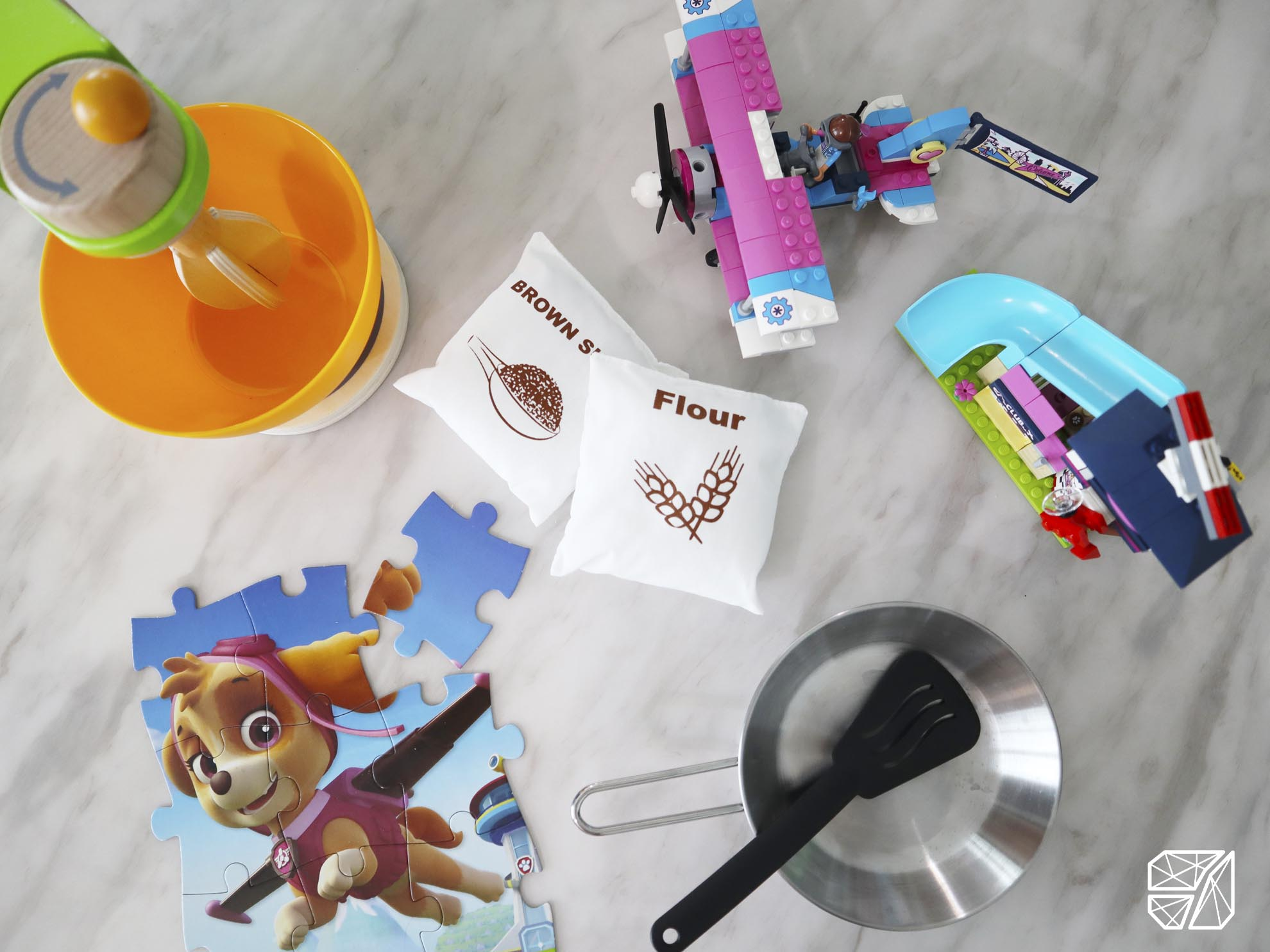 Jigsaw puzzle, baking tools, Lego blocks, frying pan and spatula